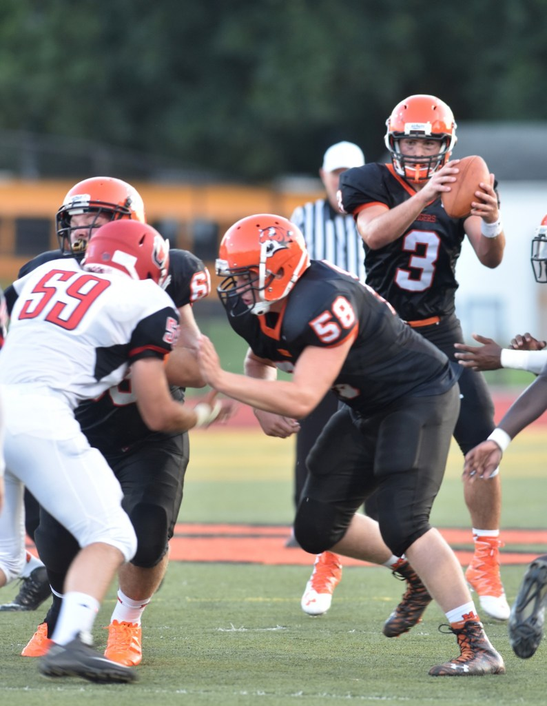 Marple Newtown quarterback Anthony Paoletti, seen in the opener against Arch. Carroll, ran for three touchdowns Friday in a 28-7 win over Radnor. (Digital First Media/Anne Neborak)