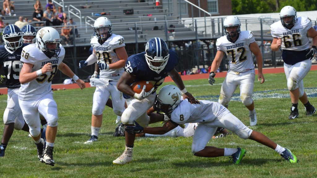 Sam Stewart - Digital First Media Pottstown's Isaiah Mayes runs through an arm tackle before being brought down by Sun Valley's AJ Basht (58). (Sam Stewart - Digital First Media)