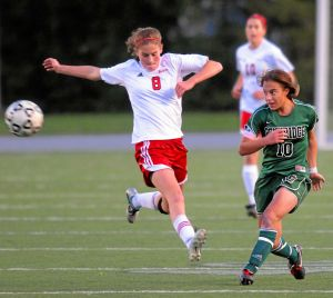 Pennridge Stevi Parker (10) fires a shot as Peter's Laurel Carpenter (8) tries to block her during the 2011 PIAA AAA Girl's Soccer Championship game. TK4