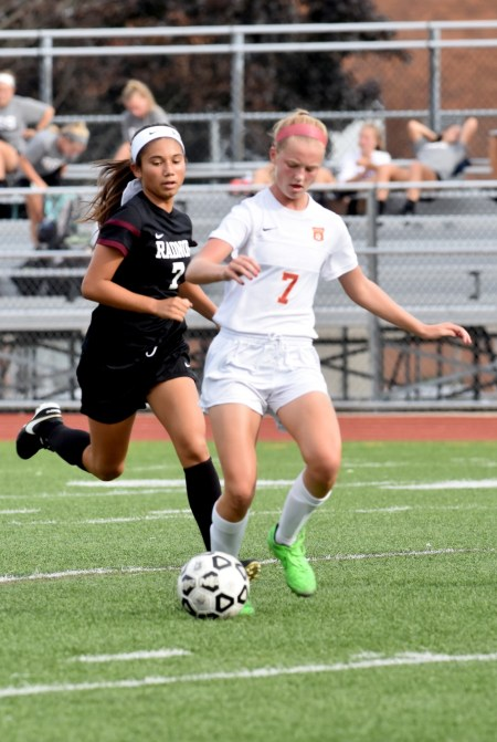 Haverford's Annalena O'Reilly, right, getting a step on Radnor's Audrey Rosenblum, scored the only goal in the Fords' 1-0 win over Radnor Tuesday. (Digital First Media/Anne Neborak)