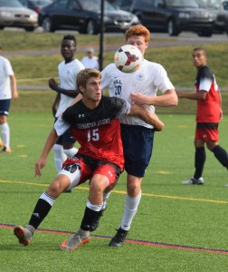 Germantown Academy's Michael Roman (15) and The Hill School's Phillip Bell compete for the ball during Wednesday's game. (Austin Hertzog - Digital First Media)