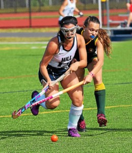 The Hill School's Sarah Esserman (13) tries to control the ball as a British School of Uruguay player defends Wednesday. (Austin Hertzog - Digital First Media)
