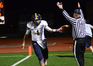 Joey Zubilaga tooses the ball to an offical after scoring the game's first TD
