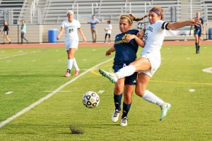 Erin Stevenson for Pennridge and Kelly Dickson for Wissahickon are both going for the ball during their game Monday.