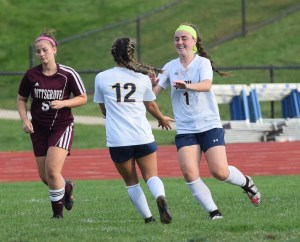 Pope John Paul II's Elizabeth Kropp (1) is congratulated by teammate Carson Tracy after scoring her team's second goal Thursday against Pottsgrove. (Austin Hertzog - Digital First Media)