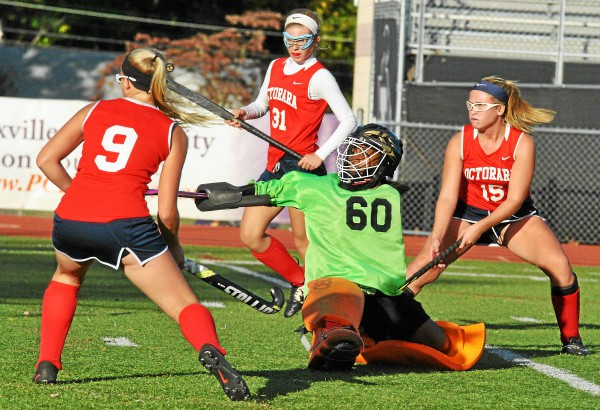 Phoenixville goalie Tyler Hall (60) deflects a shot as Octorara's Mackie Sheeler, Hope Peppernick and Hannah Sellers pressure Monday. (Barry Taglieber - For Digital First Media)