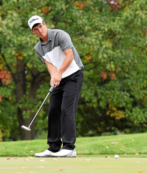 Methacton's Kyle Vance rolls his putt on No. 13 Monday during the PIAA East Region Golf Championships at Golden Oaks Golf Club in Fleetwood. (Austin Hertzog - Digital First Media)