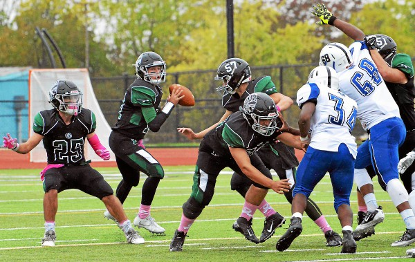 Methacton quarterback Jason Eckman looks for an open receiver on Saturday against Norristown. (Debby High - Digital First Media)