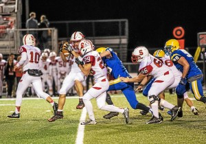 Downingtown East's Nicolas Hesel ruins a counter play by tackling Souderton's Brandon Taragna in the backfield. (NATE HECKENBERGER - FOR DIGITAL FIRST MEDIA)