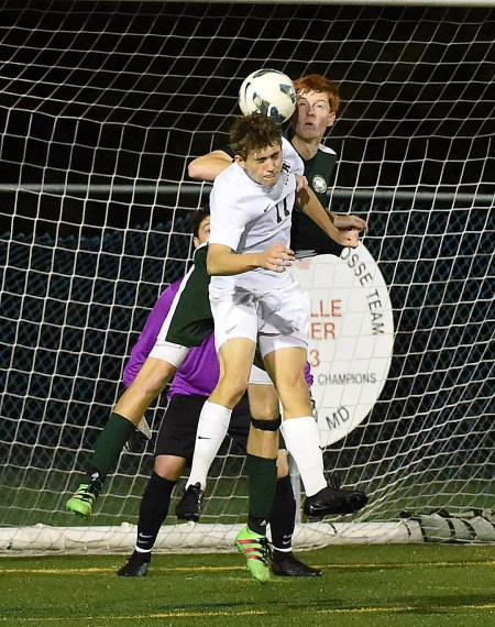 Radnor's Ryan Peter (11) collides with Bishop Shanahan's John George in overtime. Peter would score the game-winning goal in Radnor's 1-0 triumph in the District 1 Class 3A semifinal to earn a state playoff berth. (Digital First Media/Pete Bannan)