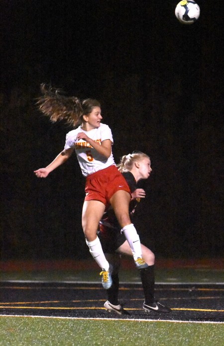 Penncrest's Olivia Mancarella, front, jumps for a header over Gwynedd Mercy's Cailin Panacek Wednesday. (Digital First Media/Anne Neborak)