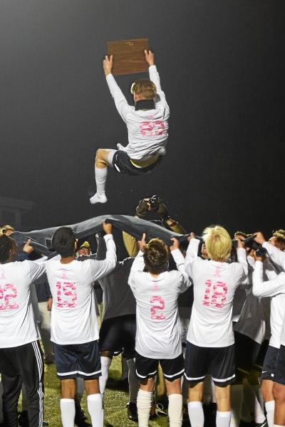 The Hill School's Jack Baughman is tossed into the air holding the championship plaque. (Austin Hertzog - Digital First Media)