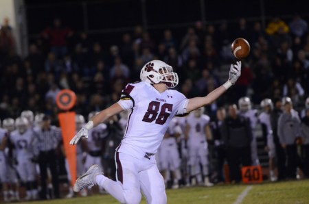 Blink and you might miss the one Garnet Valley completion, hauled in by tight end Jon Ricci here. But 426 rushing yards on nights like Friday's 44-27 upset of Perkiomen Valley alleviates the need to air it out.  (Digital First Media/Sam Stewart)