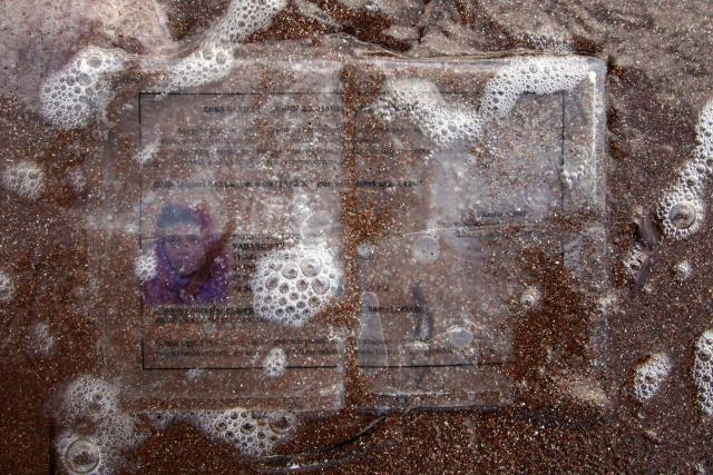 Greece/Lesvos island/August 17,2008. A lost document belonging to a Somalian refugee woman, in Ferogia beach in the greek island of Lesvos. Giorgos Moutafis