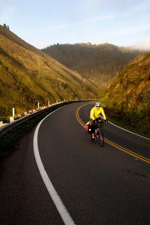 A male cyclist rides his touring bike down the Pacific Coast Highway near Fort Bragg, California. Image downloaded by anonymous anonymous at 13:43 on the 28/03/16