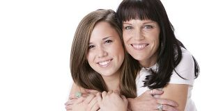 Real People: Smiling Caucasian Mother Daughter Hugging Head Shou