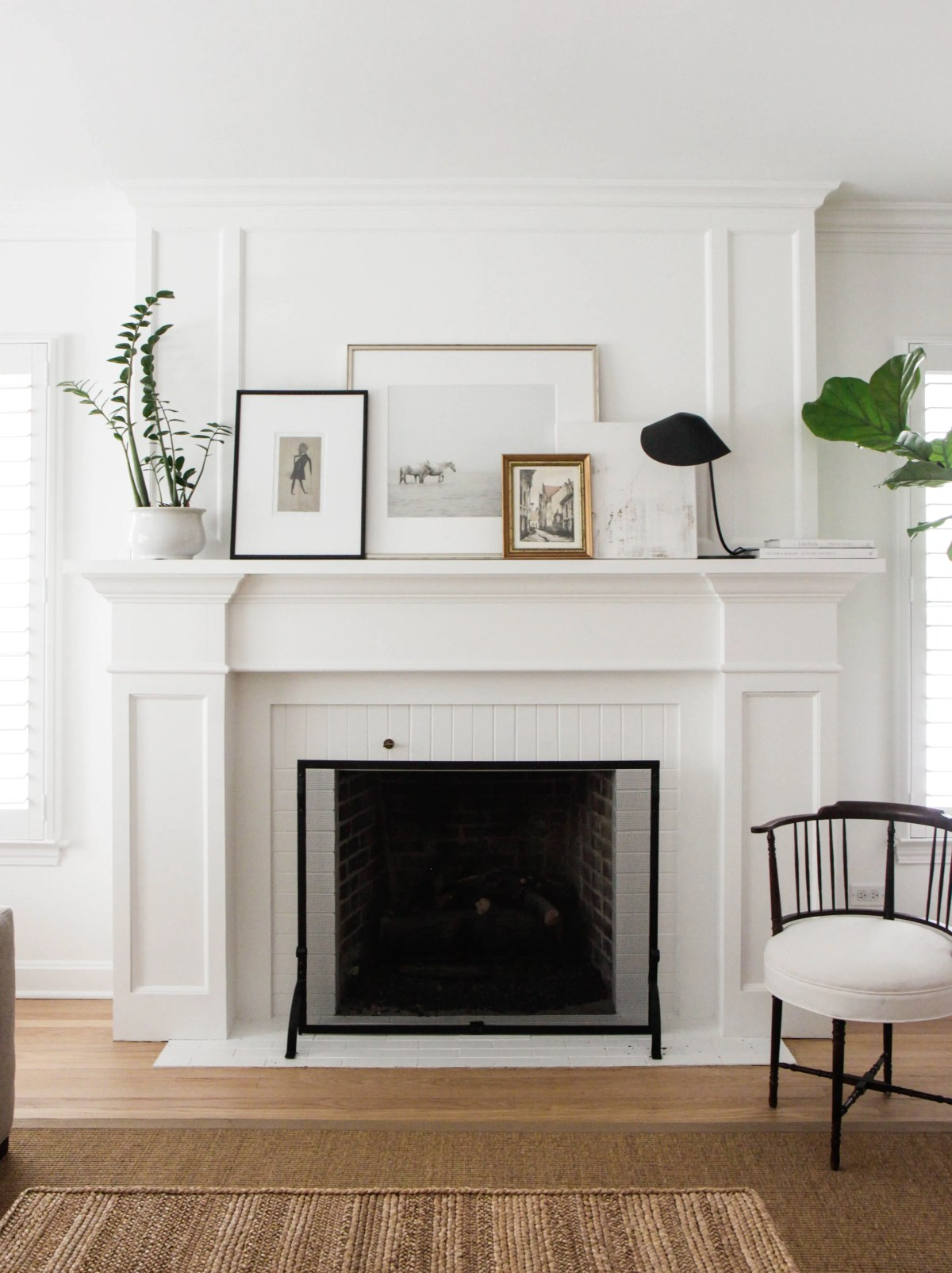 white mantel styling with layered art