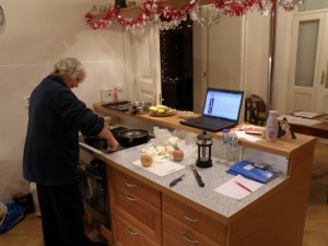 Karin in kitchen cooking for Christmas, computer recipe