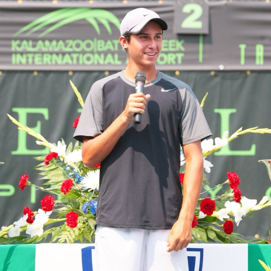 Brenden graciously speaks to the 3000 person crowd after receiving the runner up trophy in doubles at Kalamazoo.