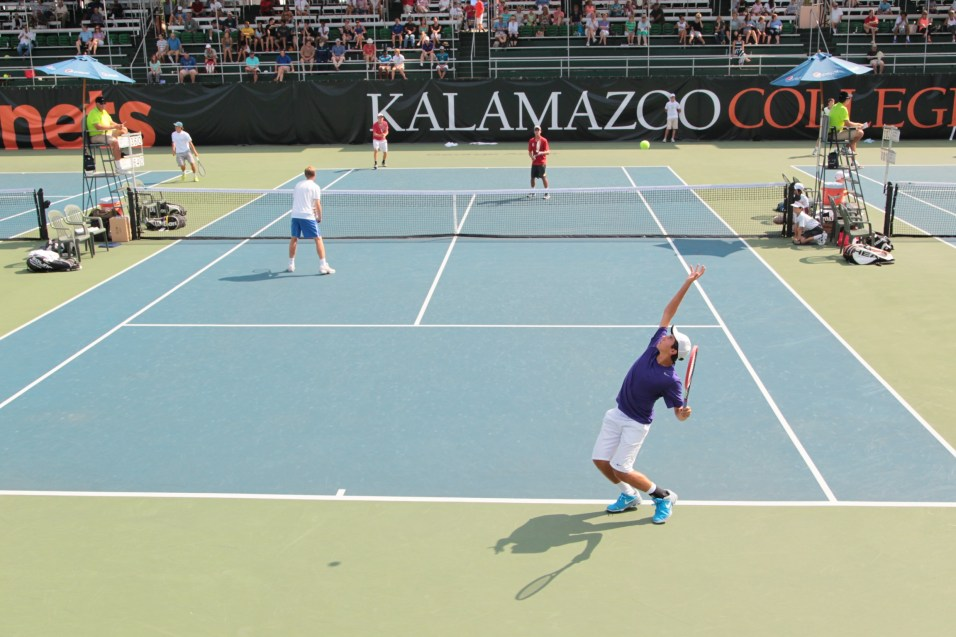 Brenden (purple) serves in the United States National Championship match in Kalamazoo, Michigan. 2014