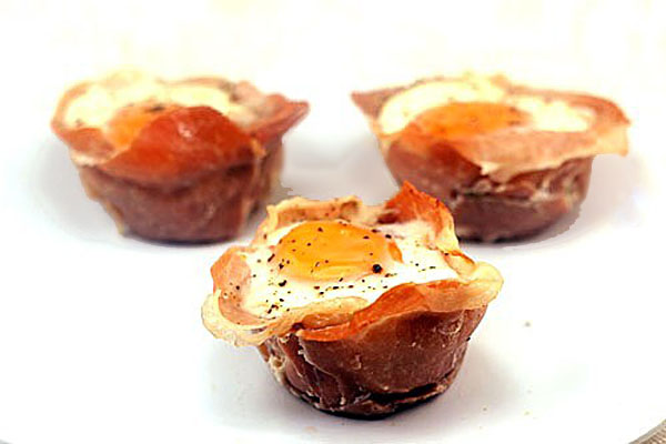 Creamy Vegetables, Cheese and Eggs in Prosciutto Cups.  Also called..Sunny Side Up 'Omelet' Cups!