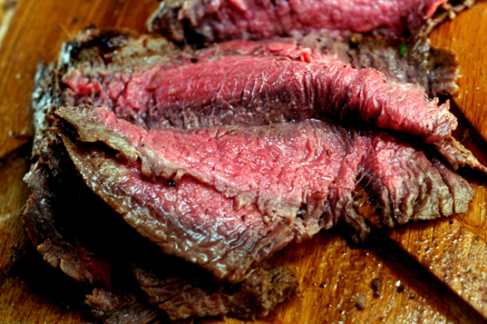 Spicy (or not) Asian Marinated Flank Steak and how to make flank steak as tender as filet mignon! It melts in your mouth - everyone goes wild for it!