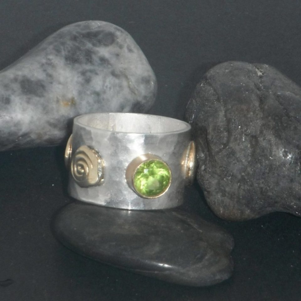Silver and 14kt gold ring set with peridot.