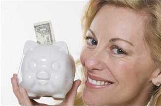 woman holding a piggy bank