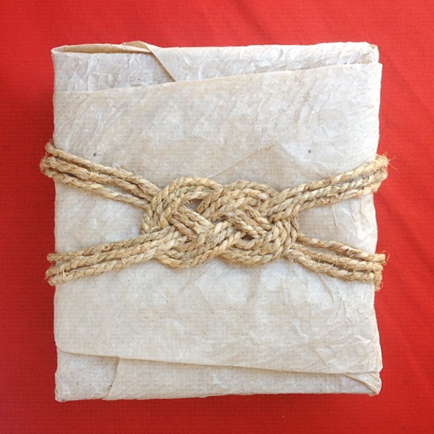 how to wrap a gift and finish it with a decorative knot