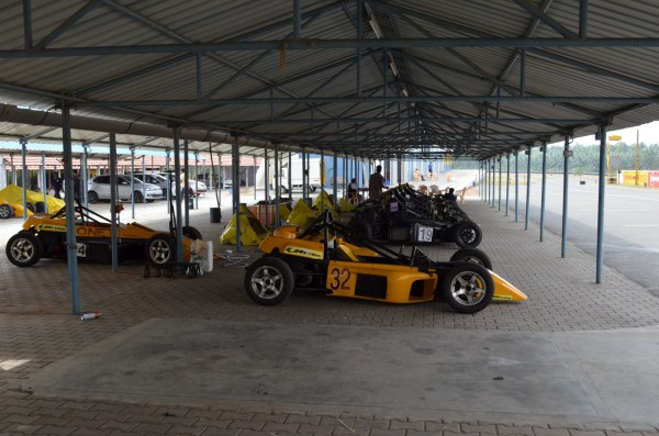 Driving with Narain Karthikeyan_Cars in the club shed