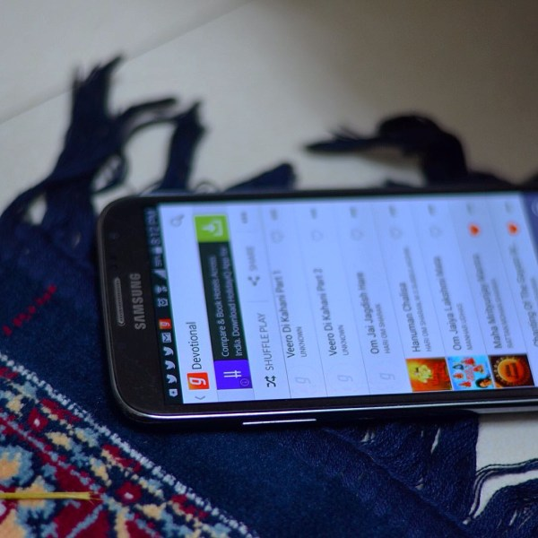 My Diwali 2014 photo-essay. Technology helps... aartis and prayers on apps.