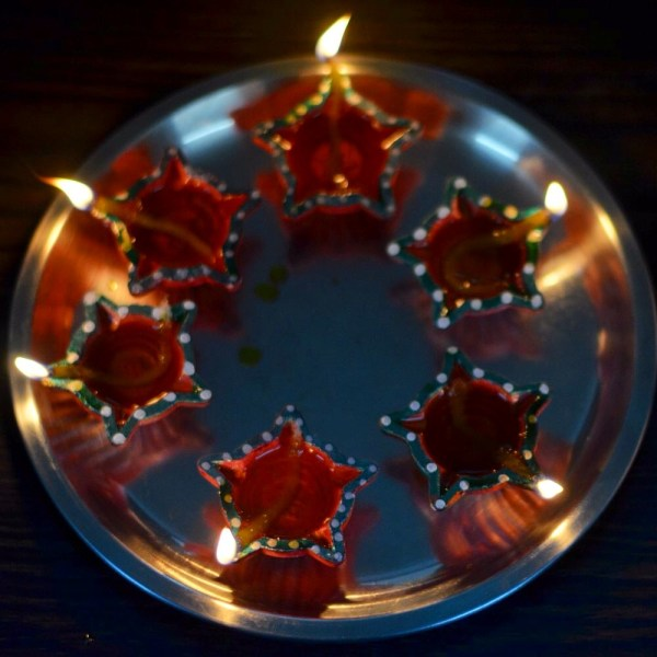 My Diwali 2014 photo-essay. Lighted diyas are first offered to the Gods and then kept all over the house.