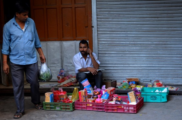 Vendors on the streets of Delhi - the early morning vendor who does business only until the shop opens