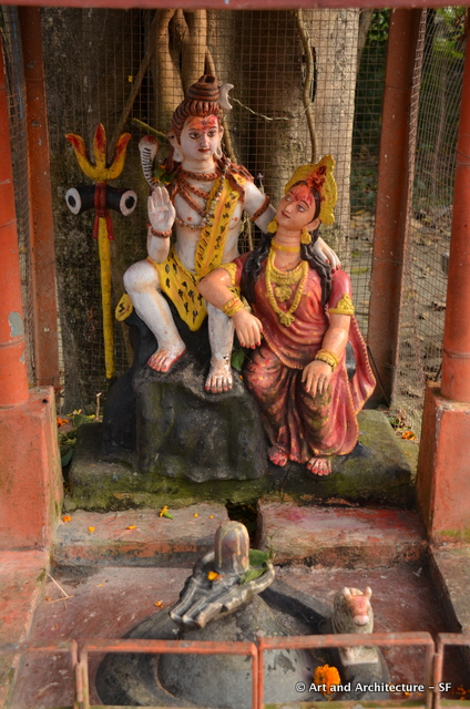 Siva and Parvati, notice the falls symbol, this is a Siva Linga.