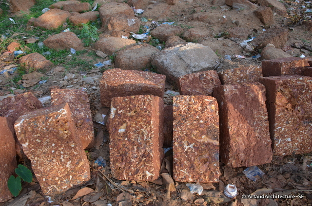 Laterites are soil types rich in iron and aluminium, formed in hot and wet tropical areas. Nearly all laterites are rusty-red because of iron oxides. They develop by intensive and long-lasting weathering of the underlying parent rock.