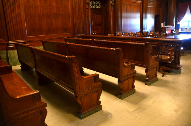 Mahogany benches in the courtrooms of the third floor