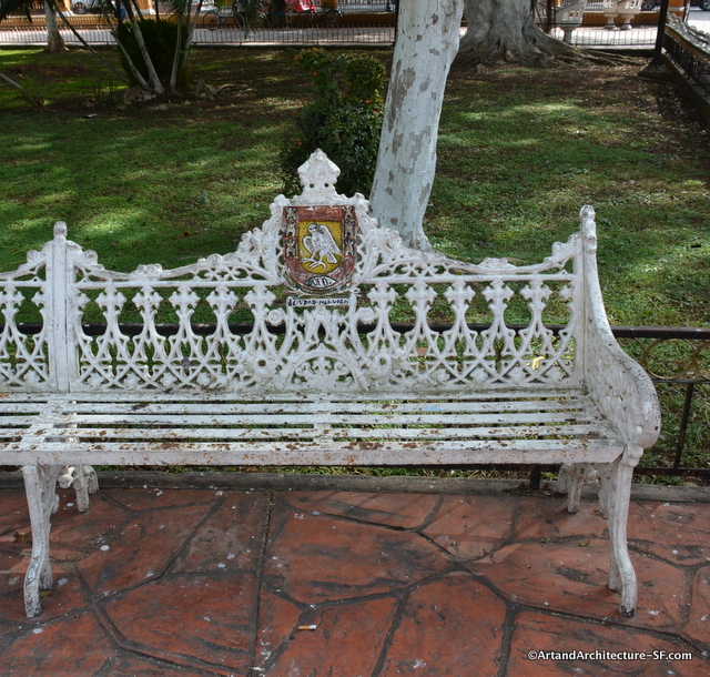 One of many beautiful wrought iron benches that line the central square.