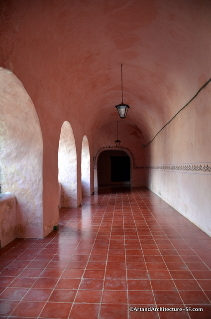 The exterior hallways showing the beautiful tiles and pink colors of the convent