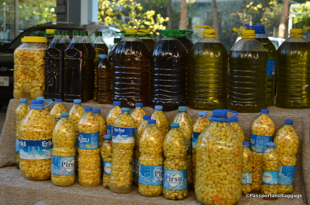 Beans soaking in oil and olive oil are a big seller on the main street.