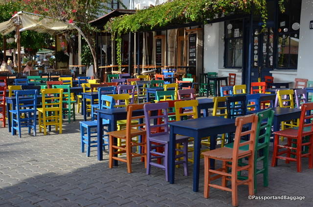 Colorful chairs at a restaurant in the central square.