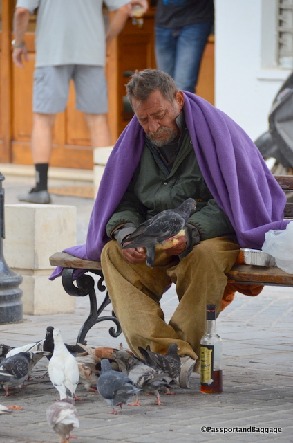 A man, a loaf of bread and the pigeons