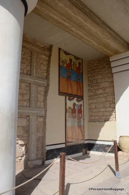 There are recreations of the frescoes found during the original excavation in-situ. The originals are in the Archeology Museum in Iraklio