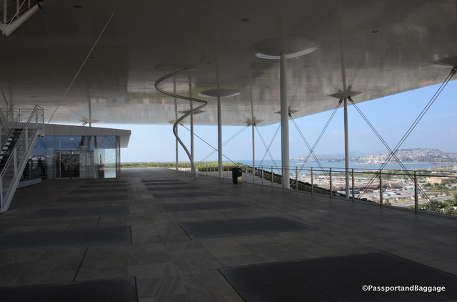 Standing on the top looking out to the sea and the interesting stanchions that support the roof
