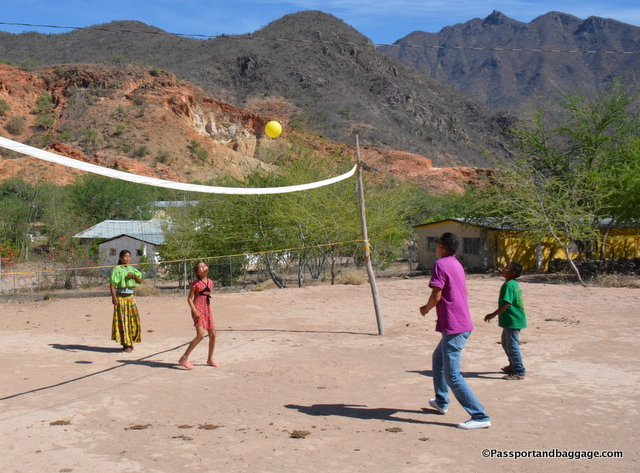 A pickup volleyball game with a few of the Taramuhara children