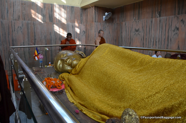 This gold robe covers the Buddha and is all one sees of the body of the Buddha