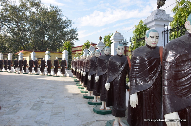 These monks are all lined up for families to adopt with offerings to the temple. They get a brass plaque once they have. All I could see was a Dr. Who episode.