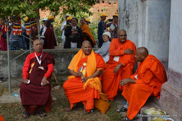 Senior monks enjoying the rest before the long walk