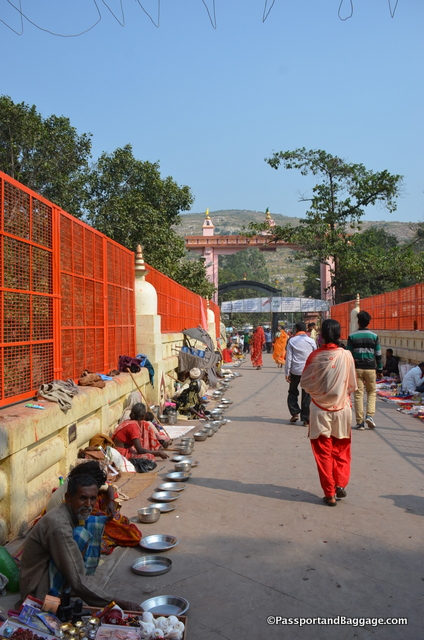 Beggars line the bridge that fronts the Hindi Temple complex