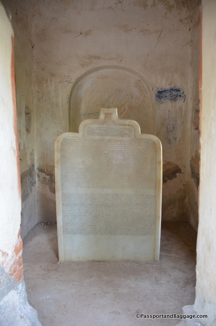 I have done a lot of research and could find no information as to what this is, what is says or why it is there. It sits inside one of the votive stupas in the garden and has, what appears to be, Sanskrit, Thai and Burmese writing.