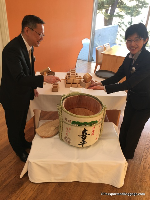 Serving spiced sake in the morning at Bennesse House